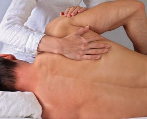 Man receiving physio for back pain