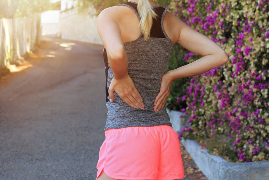 Sports woman with back pain