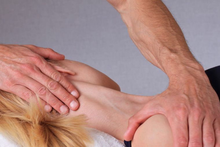 Chiropractor providing treatment